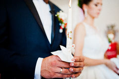 Candles at hands of wedding couple Royalty Free Stock Photo