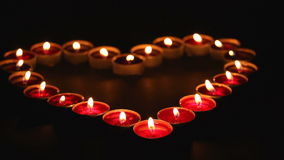 Candles heart in blackness stock video
