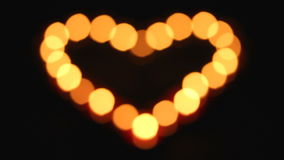 Candles heart in blackness stock footage