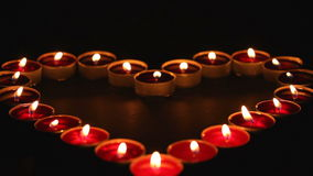 Candles heart in blackness stock video footage