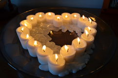 Candles in a heart. Melting candles in a heart. Romance Royalty Free Stock Photo