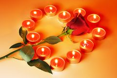 Candles Heart and Rose. Candles Heart and Red Rose on Fiery Color Background Stock Image