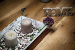 Candles with home sign blurred on wooden table- rest and relaxation Stock Image
