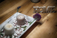 Candles with home sign on wooden table- rest and relaxation Royalty Free Stock Image