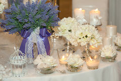 Candles, hydrangeas and white roses Stock Images