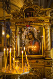 Candles and icon in russian church Royalty Free Stock Photos