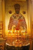 Candles and icon in russian church. Candles and icon in orthodox russian church Stock Photos