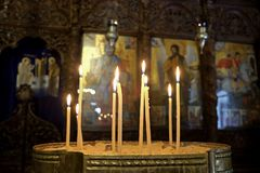 Free Candles In Front Of The Iconostasis Of The Greek Orthodox Church In Nazareth Royalty Free Stock Image - 135755656