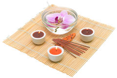 Candles, incense sticks and orchid Stock Photos