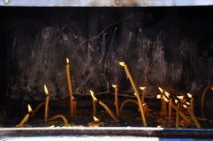 Candles inside a church  Stock Photos