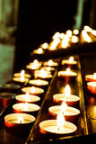 Candles inside church. Lots of candles inside a dark church royalty free stock photo