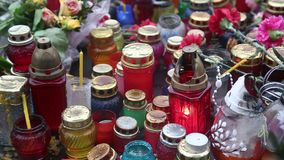 Candles inside many-coloured lamps stock footage
