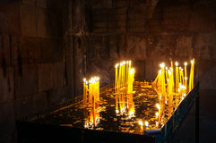 Candles inside a Noravank monastery in Armenia Royalty Free Stock Photography