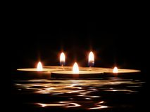 Candles and its reflection. In dark water stock photography