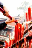 Candles and joss sticks Stock Photography