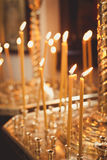 Candles and lamp close-up. Interior Of Orthodox Church. In Easter. baby christening. Ceremony a in Christian . bathing the into the baptismal font Royalty Free Stock Images
