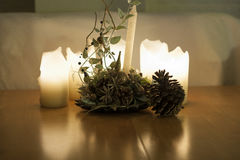 Candles with large corn and ikebana Royalty Free Stock Photography