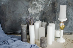 Candles and lavender flowers on a background of gray wall. With a blue cloth Royalty Free Stock Photos