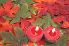 Candles and leaves Royalty Free Stock Images