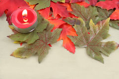 Candles and leaves Royalty Free Stock Photography