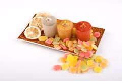 Candles with lemon and candy Royalty Free Stock Photo