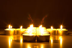 Candles with lens flares in shape of little hearts Royalty Free Stock Image