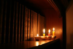 Candles and Library. A few candles lighting up old books in a library stock photo