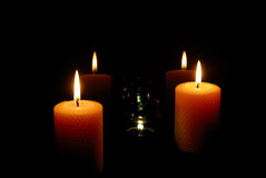Candles light. Warm candles light in darkness Royalty Free Stock Photos
