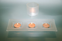 Candles light. Detail of modern interior, candles in glass holder Royalty Free Stock Image