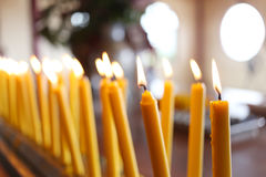 Candles light of burning at temple in abstract candles backgroun Stock Image