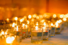 Candles light. Christmas candles burning at night. Abstract candles background. Golden light of candle flame Royalty Free Stock Images