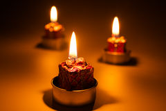 Candles light. Christmas candles on dark background Royalty Free Stock Photos