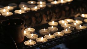 Candles light in church. Dark background. stock video footage