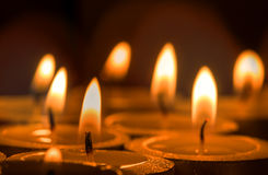 Candles light in darkness Stock Image
