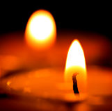 Candles light in darkness. Hot candles light in darkness Stock Image