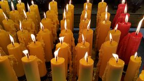 Candles light offering. Royalty Free Stock Photography