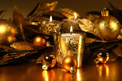 Candles light in sparkling gold Stock Photos