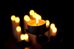 Candles. Lighted candles in the dark Stock Photo