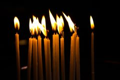 Candles lighten up in a Greek chapel stock image