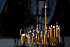 Candles lighting in church Stock Photos