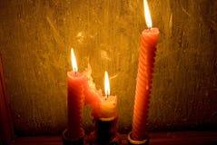 Candles lighting a frozen window stock photos