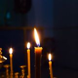 Candles lighting in russian orthodox church Royalty Free Stock Photos