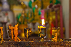 Candles lighting in temple Stock Images