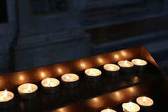 Candles lights. Church candles. Candles lights in church somewhere in Italy royalty free stock image