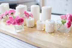 Candles with lights. composition on the table. cute home decor with candles and flowers stock photo