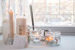Candles with lights. composition on the windowsill. cute home decor with candles and aroma stick. Calmness relax, unplug,. Mindfulness concept royalty free stock photos