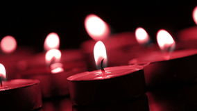 Candles lights in a red tone stock video