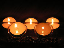 Candles in the line. Five candles in two lines stock photo