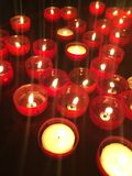 Candles in Lisbon. Red candles church religion Portugal Royalty Free Stock Photography