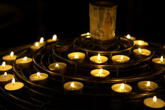 Candles lit as a prayer, Notre dame, cathedral, paris, france. Horizontal stock photo